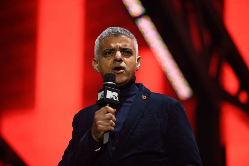 London Mayor Sadiq Khan takes the stage to make a speech ahead of a concert by Irish rock band U2 and French DJ David Guetta in Trafalgar Square in central London on Nov. 11, 2017.