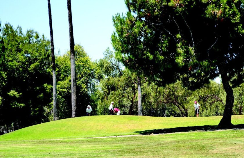 Golfers enjoy a round Tuesday afternoon at the StoneRidge Country Club in Poway.