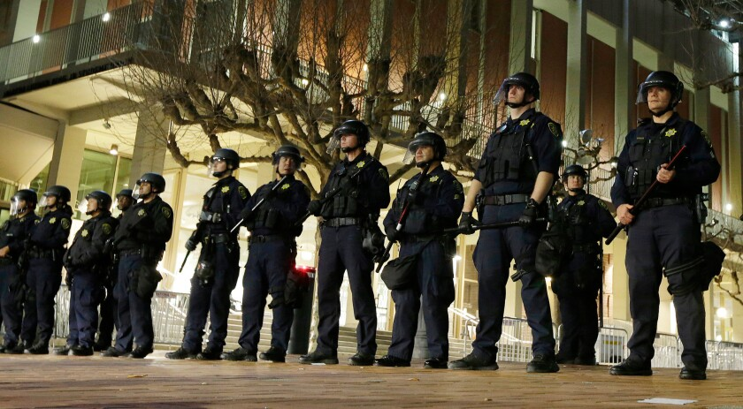 UC Berkeley police guard the building where right-wing provocateur Milo Yiannopoulos was to speak on Feb. 1, 2017.