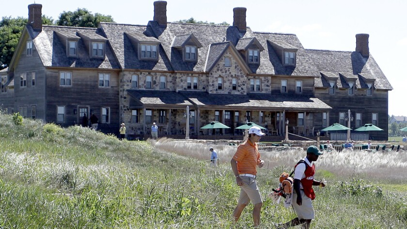 Peter Uihlein and his caddie make their way toward the first fairway at Eric Hills during the 2011 U.S. Amateur.