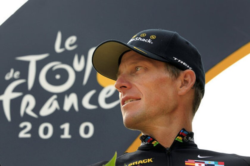 Lance Armstrong stands on the podium after the 20th and last stage of the Tour de France.