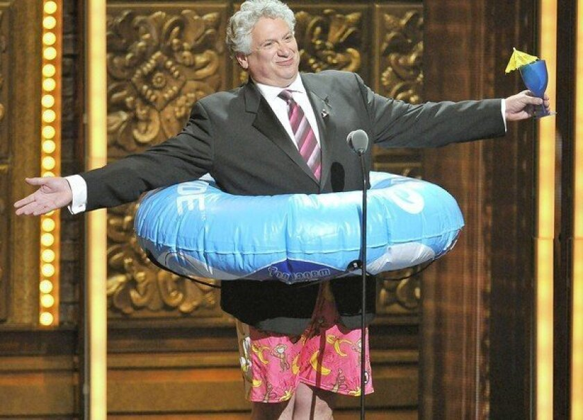 Harvey Fierstein appears in an unusual outfit to introduce the Royal Caribbean spot.