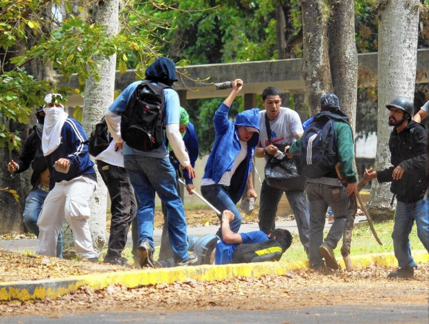 Pro-government assailants beat a student at the Central University of Venezuela on Thursday. A university official said the campus, in Caracas, had been invaded by motorcycle-riding vigilantes at least 10 times since student-led government protests began sweeping the country in early February.
