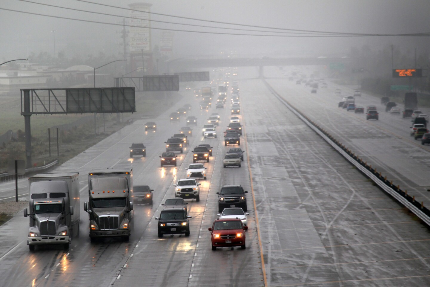Traffic moves along I-15 North during a rainy morning Dec. 31, 2016 in Fontana.