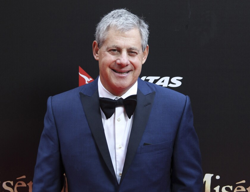 """FILE - This Dec. 21, 2012 file photo shows Cameron Mackintosh, producer of the stage production of """"Les Miserables"""" in Sydney, Australia for the premiere of the film version. Some of London's biggest West End shows, including """"Hamilton"""" and """"The Phantom of the Opera,"""" won't reopen until next year, producers announced Wednesday June 17, 2020, as arts bodies warned that Britain faces a """"cultural catastrophe"""" because of the coronavirus pandemic. (AP Photo/Rob Griffith, File)"""