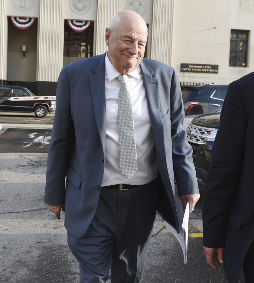 UAW official Edward Robinson leaves federal court in Detroit, Monday, March 2, 2020. The former senior official at the United Auto Workers pleaded guilty to conspiring with other labor leaders to steal more than $1 million in dues while enjoying golf, lavish lodging, meals and booze. (Clarence Tabb Jr. /Detroit News via AP)