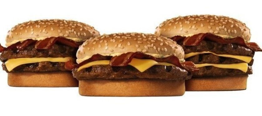 """Burger King bacon cheeseburger """"BK Stackers."""" The fast food chain said it will use only cage-free eggs and pork by 2017."""