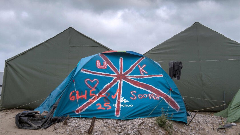 """A tent is painted with the British flag at the """"Jungle"""" migrant camp in Calais, France"""