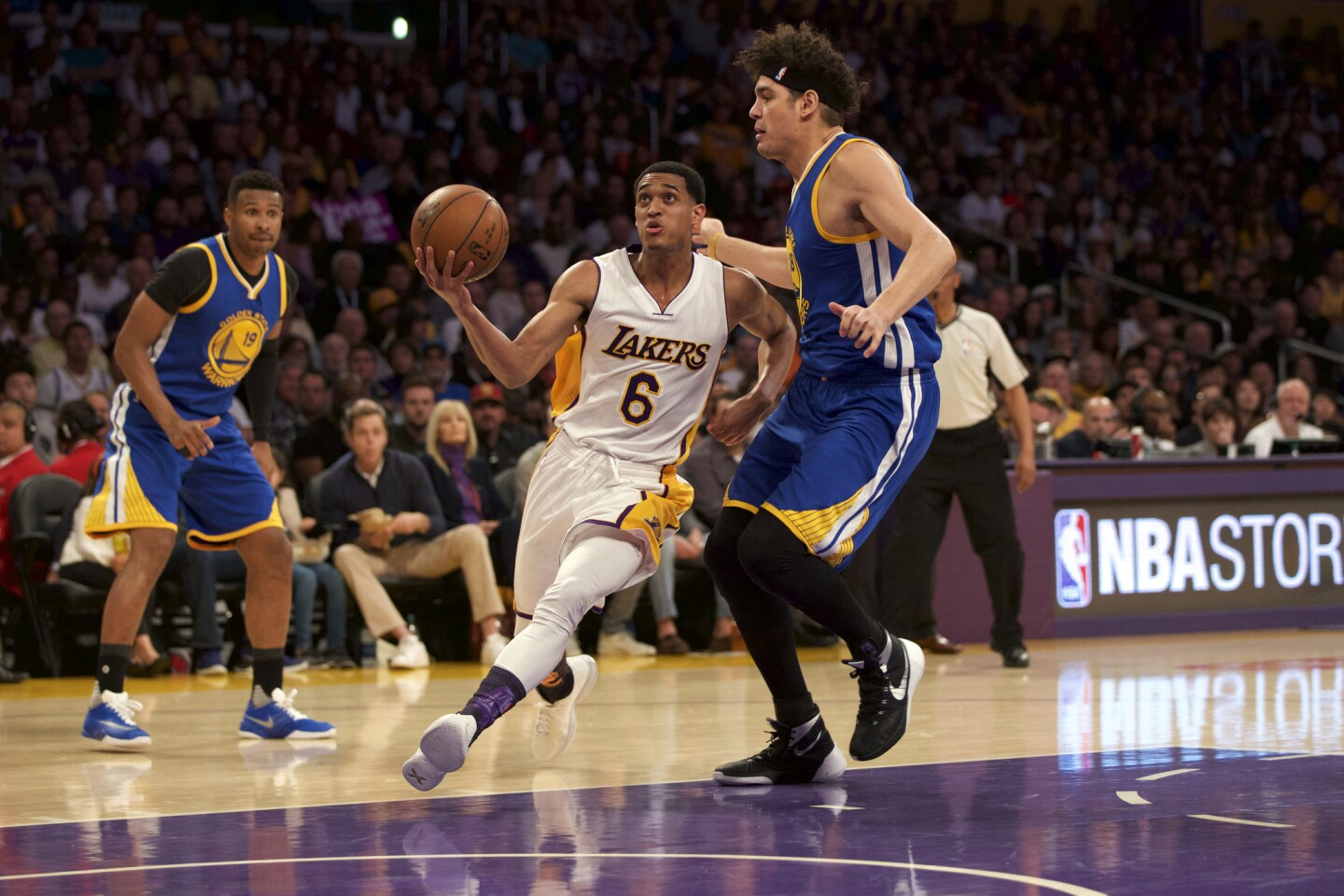 Lakers guard Jordan Clarkson drives past Warriors forward Anderson Varejao during a game March 6 at Staples Center. Clarkson led all scorers with 25 points.