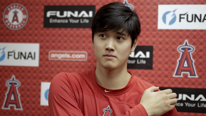 FILE - In this Feb. 13, 2019, file photo, Los Angeles Angels' Shohei Ohtani, recovering from Tommy J