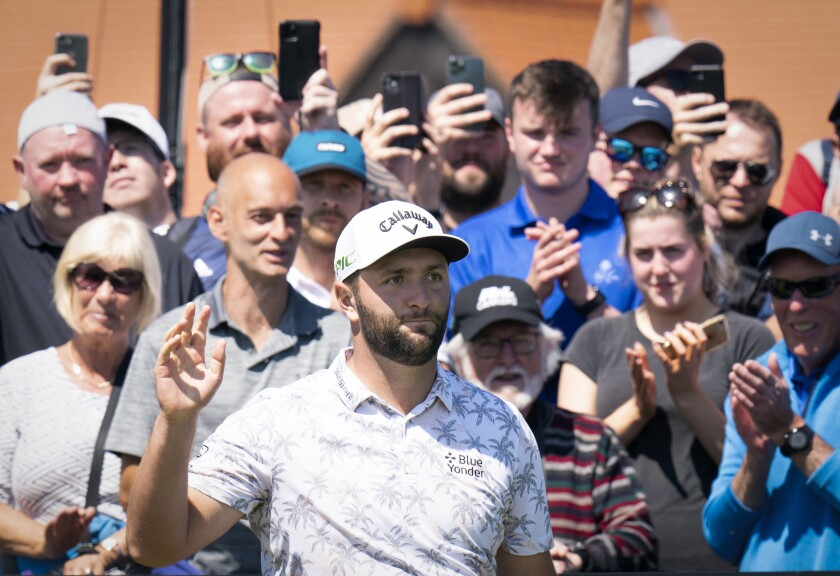 Spain's Jon Rahm gestures on the 1st tee during day one of the Golf Scottish Open, at The Renaissance Club, North Berwick, Scotland, Thursday July 8, 2021. (Jane Barlow/PA via AP)