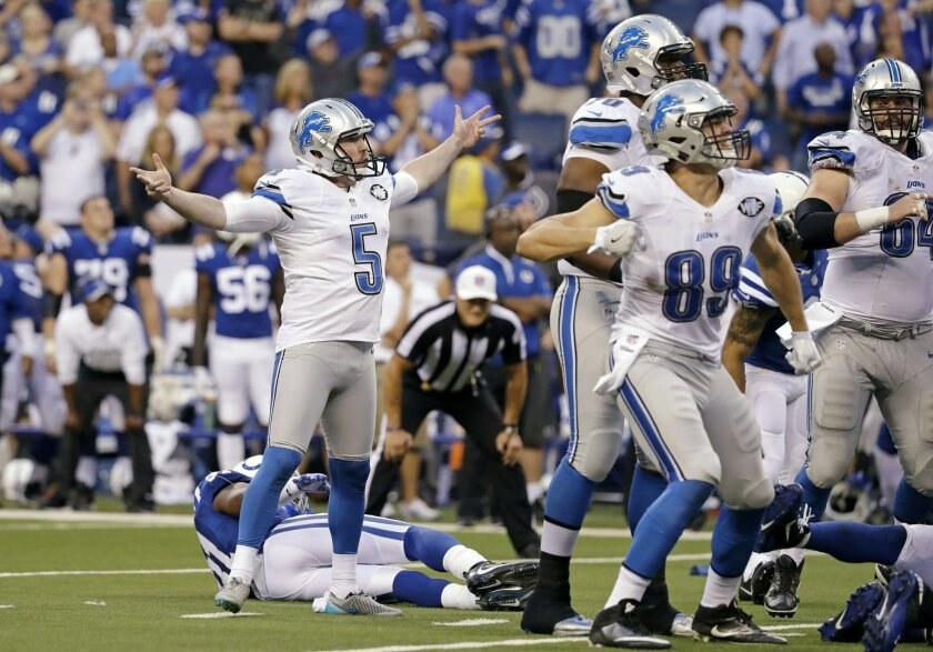 Detroit Lions kicker Matt Prater (5) celebrates a game-winning field goal in the final seconds of the game against the Indianapolis Colts in an NFL football game in Indianapolis, Sunday, Sept. 11, 2016. The Lions defeated the Colts 39-35. (AP Photo/Jeff Roberson)