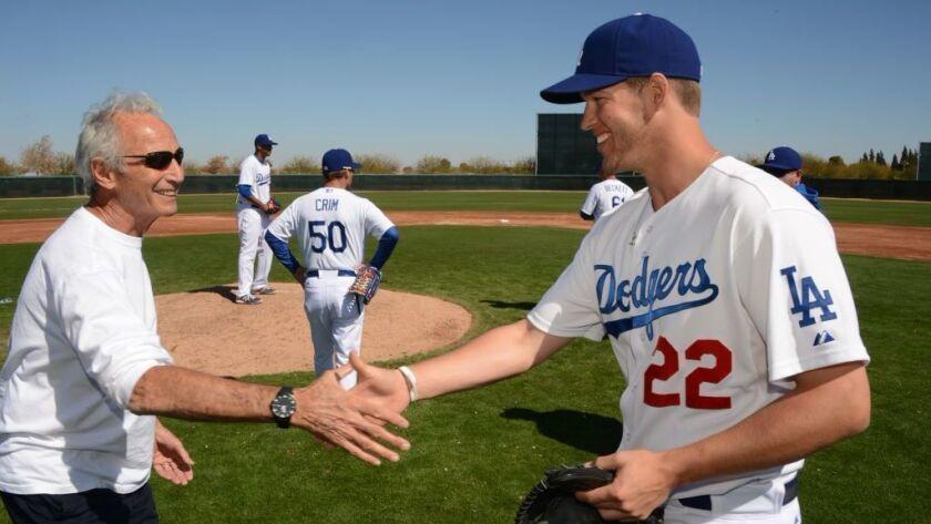 Former Dodger pitcher Sandy Koufax, Lt, shaking hands with Dodger ace Clayton Kershaw.