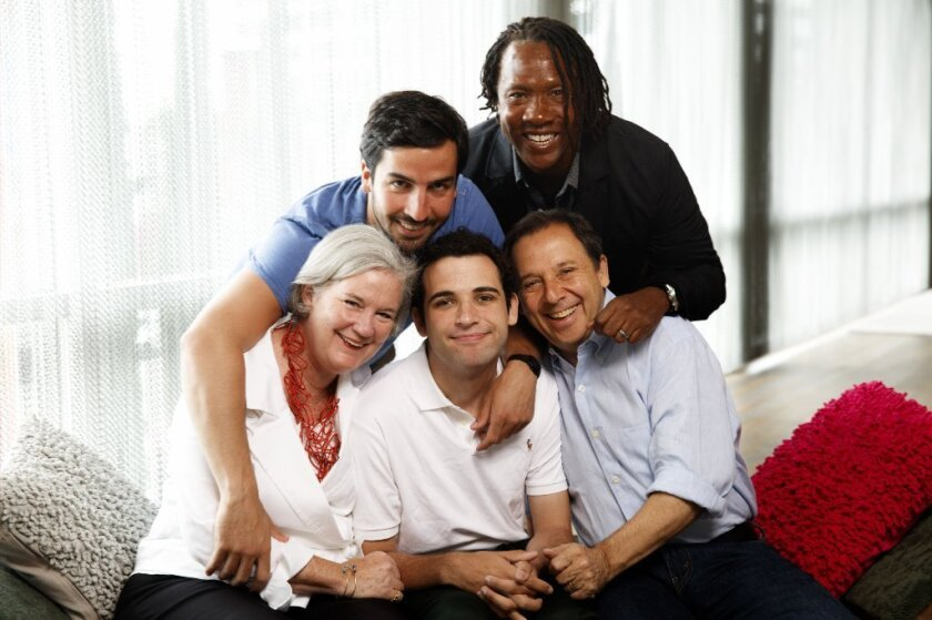 "Owen Suskind, center, an autistic young man who is the subject of the documentary ""Life Animated"" is shown with his family, including, from left, mother Cornelia, brother Walter, father Ron and director Roger Ross Williams."