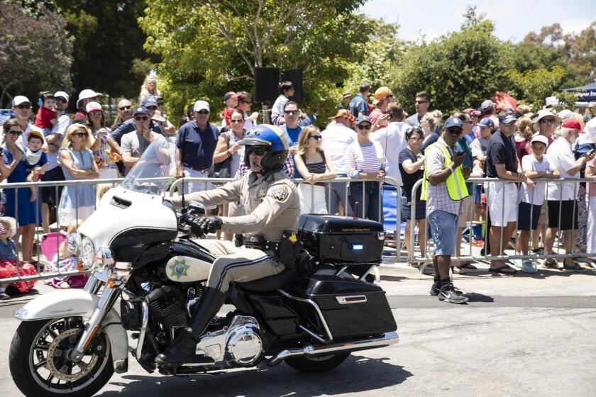 A CHP officer leads the way in this year's Fourth of July parade.