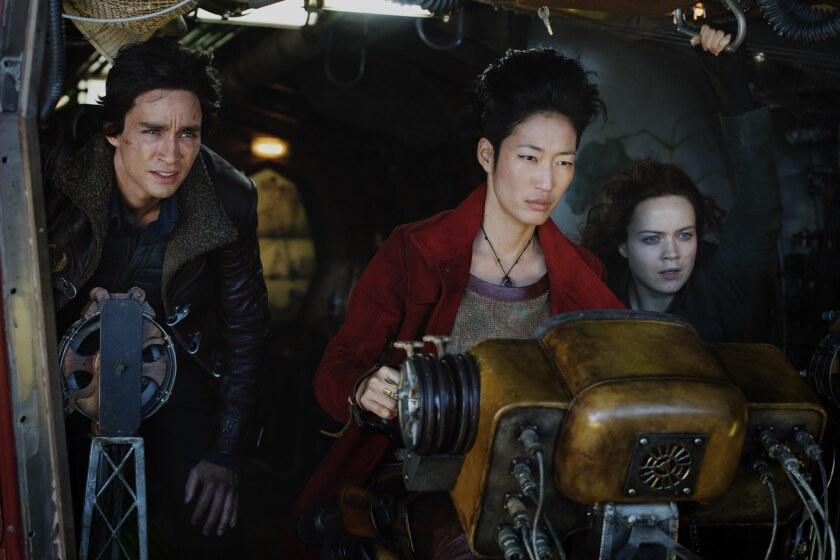 "(L-R) - Robert Sheehan as Tom Natsworthy, Jihae as Anna Fang and Hera Hilmar as Hester Shaw in ""Mort"