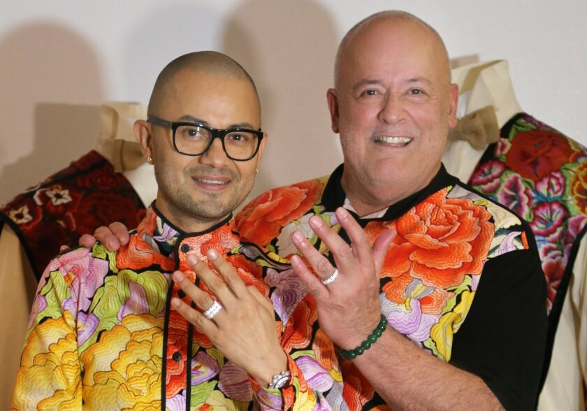 Luis Vargas (L) and Michael Bujazan show their wedding rings. They are the first same-sex couple to legally marry in Tijuana. Photo by Jesus Bustamante/Frontera