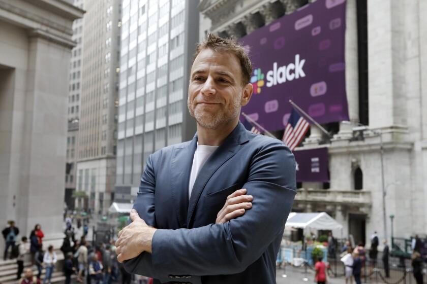 Slack Chief Executive Stewart Butterfield stands outside the New York Stock Exchange before his company's 2019 IPO.