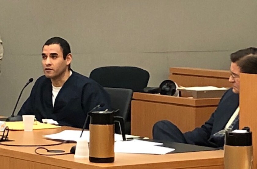 Henry Lopez, with defense attorney Paul Neuharth Jr. at right, told the judge at sentencing Wednesday that justice was not done at his conviction.