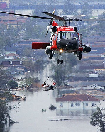 A person is lifted to safety by a Coast Guard helicopter Monday in New Orleans.