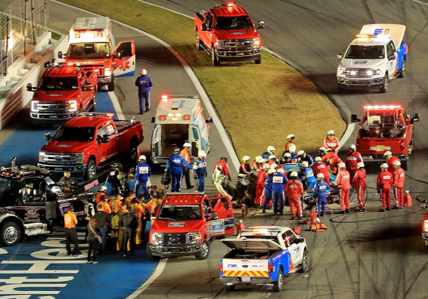 Medical workers attend to Ryan Newman following his last lap crash during the Daytona 500 on Monday.