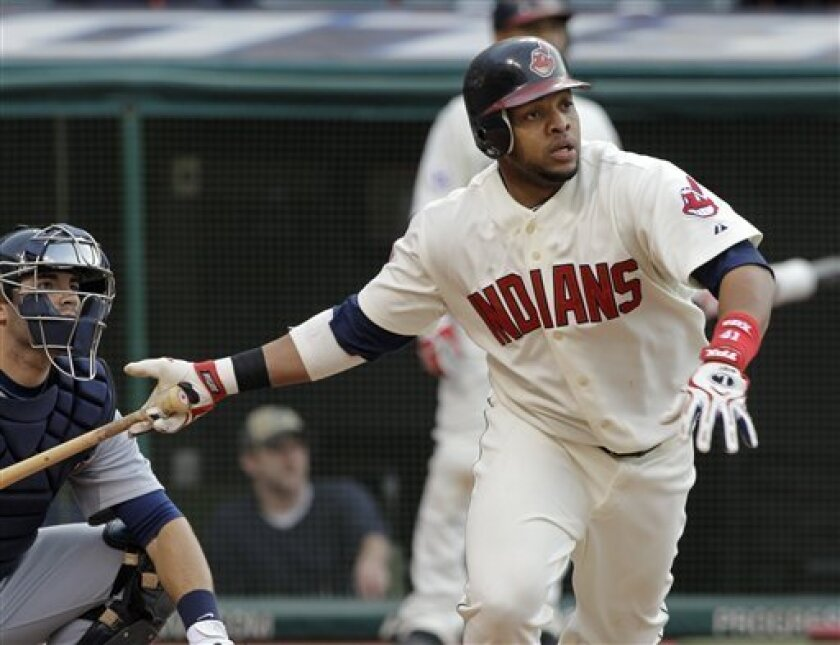 Cleveland Indians' Carlos Santana watches his solo home run with Detroit Tigers catcher Alex Avila, left, in the fourth inning of a baseball game Saturday, April 30, 2011, in Cleveland. (AP Photo/Mark Duncan)