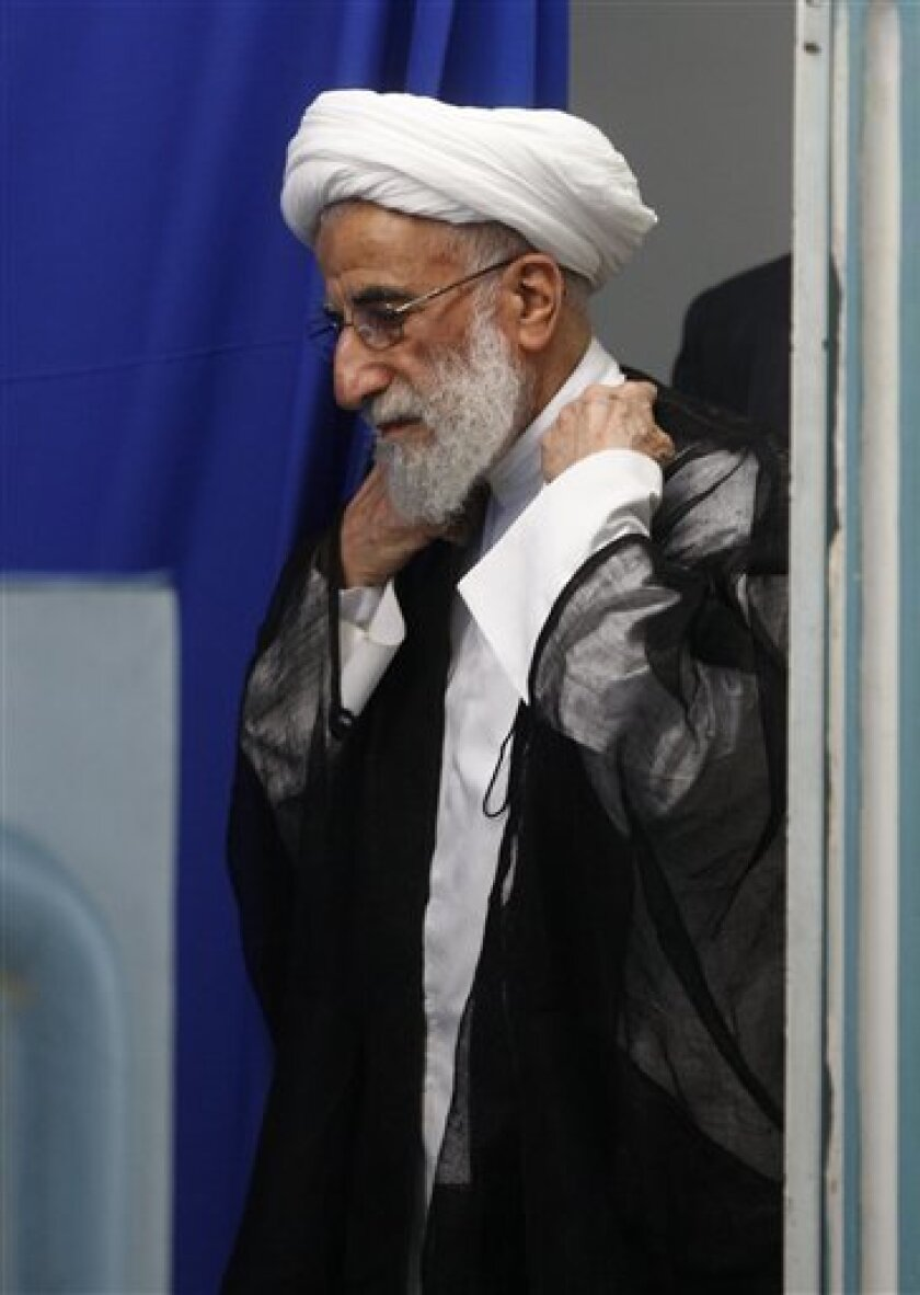 Top Iranian cleric Ayatollah Ahmad Jannati, arrives to deliver his sermon during Friday prayers at the Tehran University campus, in Tehran, Iran, Friday, July 3, 2009. Jannati, who is the head of the Guardian Council, a powerful body in Iran's ruling clerical hierarchy that stands above the elected government, said Friday that some of the detained Iranian staffers of the British Embassy in Tehran will be put on trial, and he accused Britain of a role in instigating widespread protests that erupted over the country's disputed presidential election. (AP Photo/Vahid Salemi)