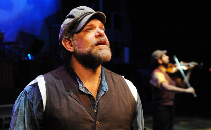 """Sam Zeller as Tevye in Lamb's Players Theatre's """"Fiddler on the Roof."""""""