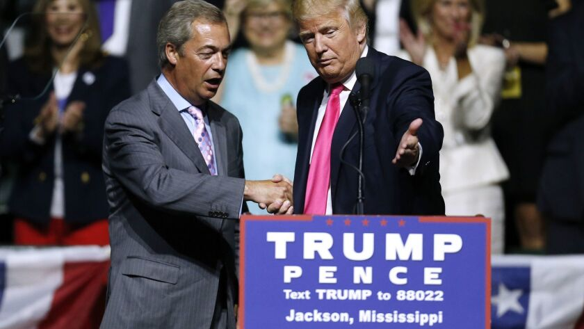 Republican Presidential nominee Donald Trump, right, invites Nigel Farage to speak during a campaign rally at the Mississippi Coliseum on August 24, 2016, in Jackson.