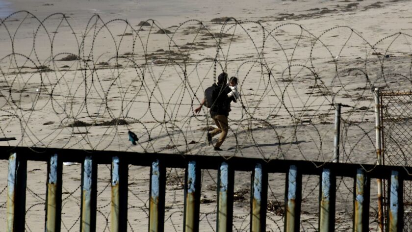 SAN DIEGO, CA- TIJUANA, MX 03-13-2019 U.S.-MEXICO BORDER WALL HONDURAN MIGRANTS BREAK THROUGH BORD