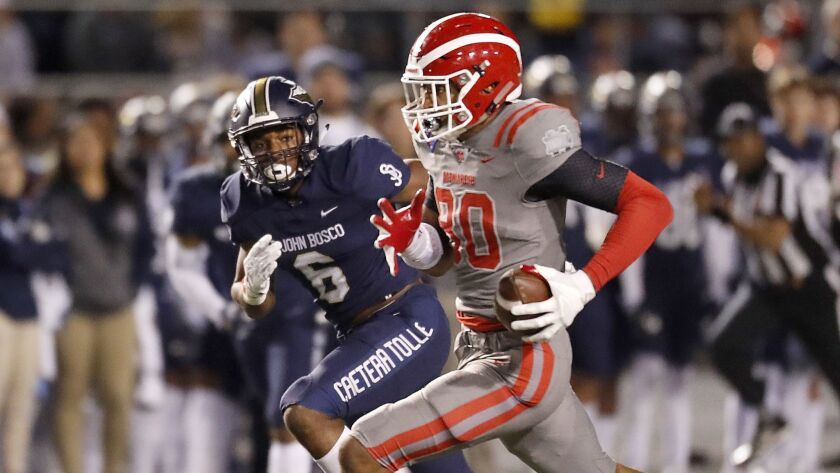 CERRITOS, CALIF. .. - NOV. 23, 2018. Mater Dei tight end ike Martinez heads uofield after making a