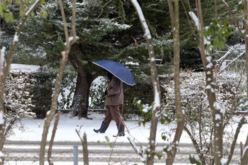 An elderly man makes his way in a snow covered street in northern Athens, Wednesday, Feb. 1, 2012. Snowfall and frost were reported in most parts of Greece for third day as European cold snap death toll rises to 71 people. (AP Photo/Thanassis Stavrakis)