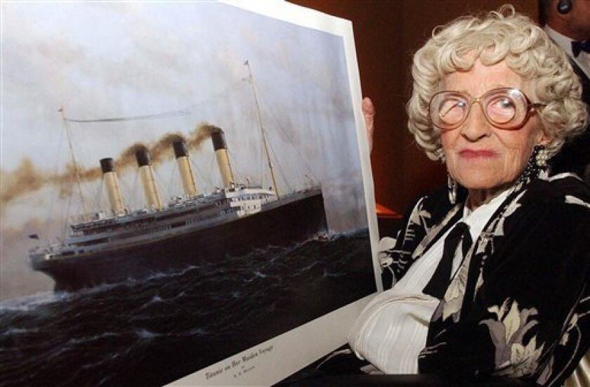 FILE - A May 19, 2003 photo from files of Millvina Dean the last living survivor of the Titanic disaster with a painting of the vessel, at an unknown location in England. The Titanic International Society says Millvina Dean, the last survivor of the sinking of the Titanic has died in her sleep. The