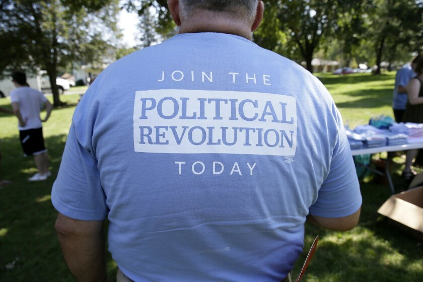 FILE - In this Sept. 3, 2015, file photo, the back of a shirt of a supporter for Democratic presidential candidate, Sen. Bernie Sanders, I-Vt., during a town hall meeting in Grinnell, Iowa. (AP Photo/Charlie Neibergall, File)