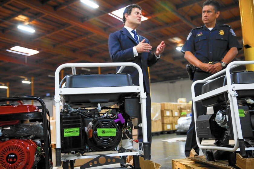 U.S. EPA Regional Administrator Jared Blumenfeld, left, at a Carson news conference announcing that federal environmental and customs officials found hundreds of imported vehicles, engines and other equipment that failed to comply with U.S. emissions standards.
