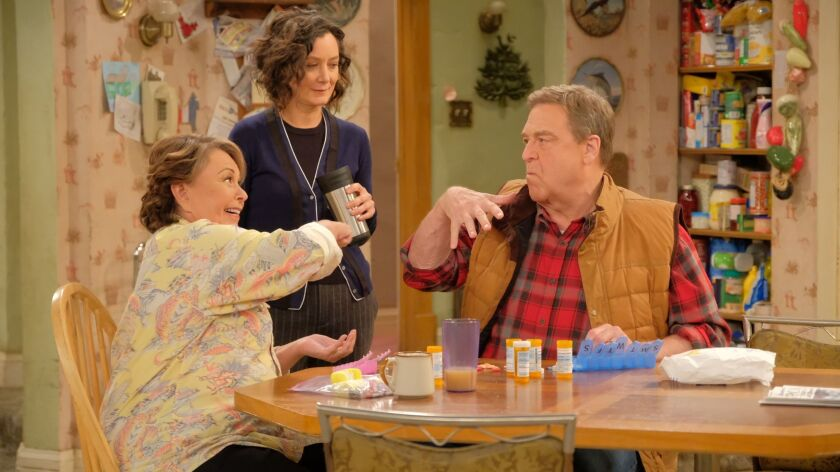 "Roseanne Barr, left, Sara Gilbert and John Goodman return as Rosanne, Darlene and Dan Conner in the decades-belated tenth season of ""Roseanne."""
