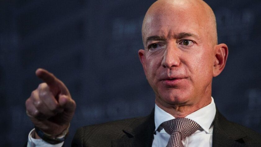 Amazon Chief Executive Jeff Bezos has accused the National Enquirer of threatening to publish intimate photos of him and former TV news anchor Lauren Sanchez unless he stopped an investigation into how it got his private messages.