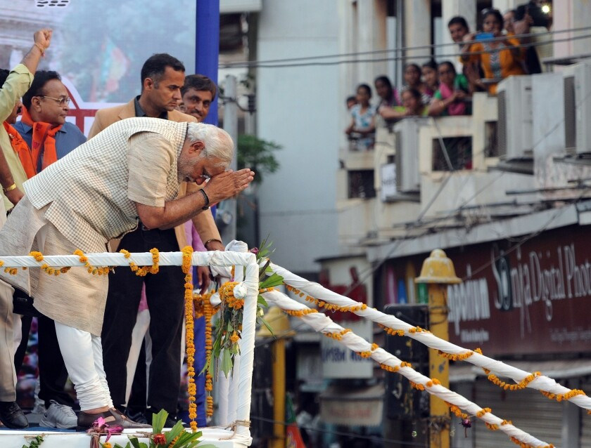 Narendra Modi bows to the crowd in Vadodara after his Bharatiya Janata Party's victory in India's national election.