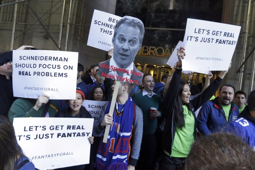 Fantasy sports fans in New York City demonstrate outside the offices of New York Atty. Gen. Eric Schneiderman in November. Schneiderman said that month that the daily fantasy sports betting sites FanDuel and DraftKings are illegal gambling operations in his state.