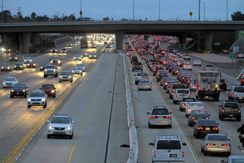 A view of the congested 405 Freeway in Costa Mesa last fall. Caltrans plans to create toll lanes on this stretch of freeway, part of a 14-mile segment in Orange County where the lanes would be placed.