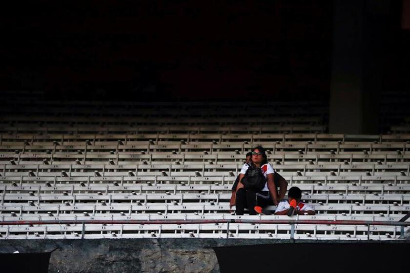 A River Plate fan in the stands at Buenos Aires' El Monumental Stadium on Nov. 24, 2018, after the second leg of the Copa Libertadores final versus arch-rival Boca Juniors was suspended due to fan violence. EPA-EFE/Juan Ignacio Roncoroni