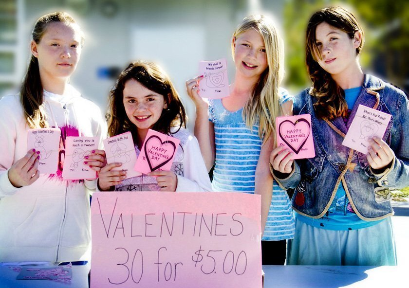 (From left) Makena Kronemyer, Carolee Hagey, Natalie Wittkow and Zia Simpson of La Jolla Elementary School display Valentines that students sold to raise money for the Rwandan Orphans Project.