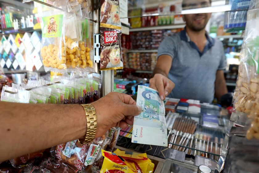 Middle-class Iranians resort to buying rotting produce as