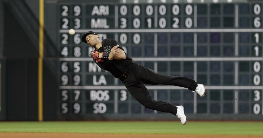 Angels shortstop Andrelton Simmons throws to first base during Friday's game against the Houston Astros.
