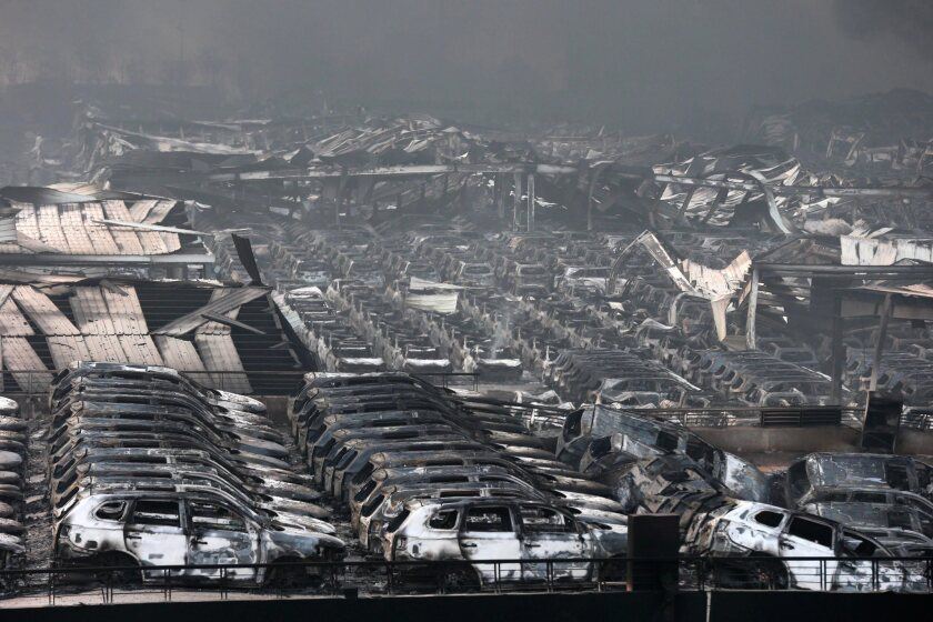 Damaged buildings and cars are seen on Aug. 13 after two huge explosions rocked the Chinese port city of Tianjin.