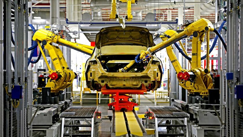 Robots build a Chrysler sedan at the Sterling Heights Assembly Plant in Sterling Heights, Mich.