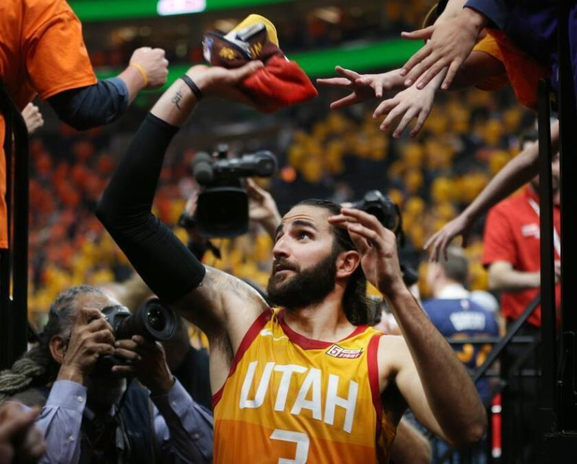 Utah Jazz guard Ricky Rubio throws a towel to a fan after the Jazz won the NBA Western Conference First Round playoffs game three against the Oklahoma City Thunder at Vivint Smart Home Arena in Salt Lake City, Utah, USA, 21 April 2018. EFE