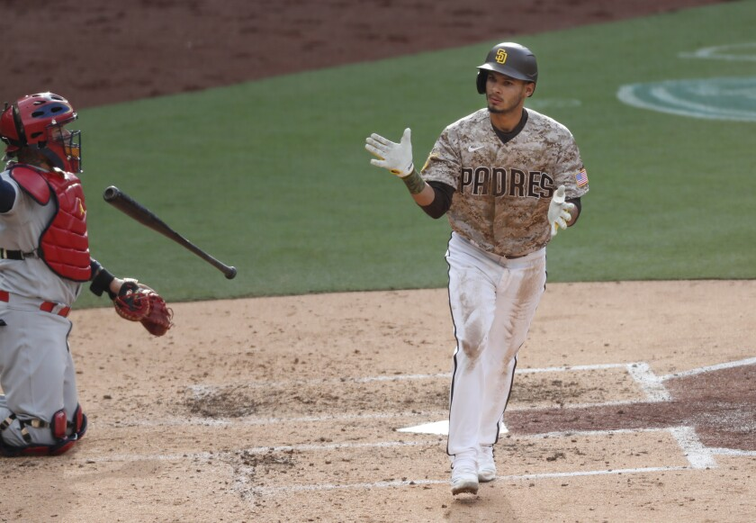 The Padres' Tucupita Marcano walks with the bases loaded against the Cardinals on Sunday, May 16, 2021 in San Diego, CA.