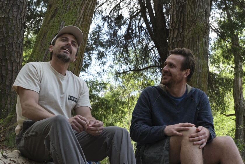 """This image released by Gravitas Ventures shows Casey Affleck, left, and Jason Segel in a scene from """"Our Friend."""" (Claire Folger/Gravitas Ventures via AP)"""