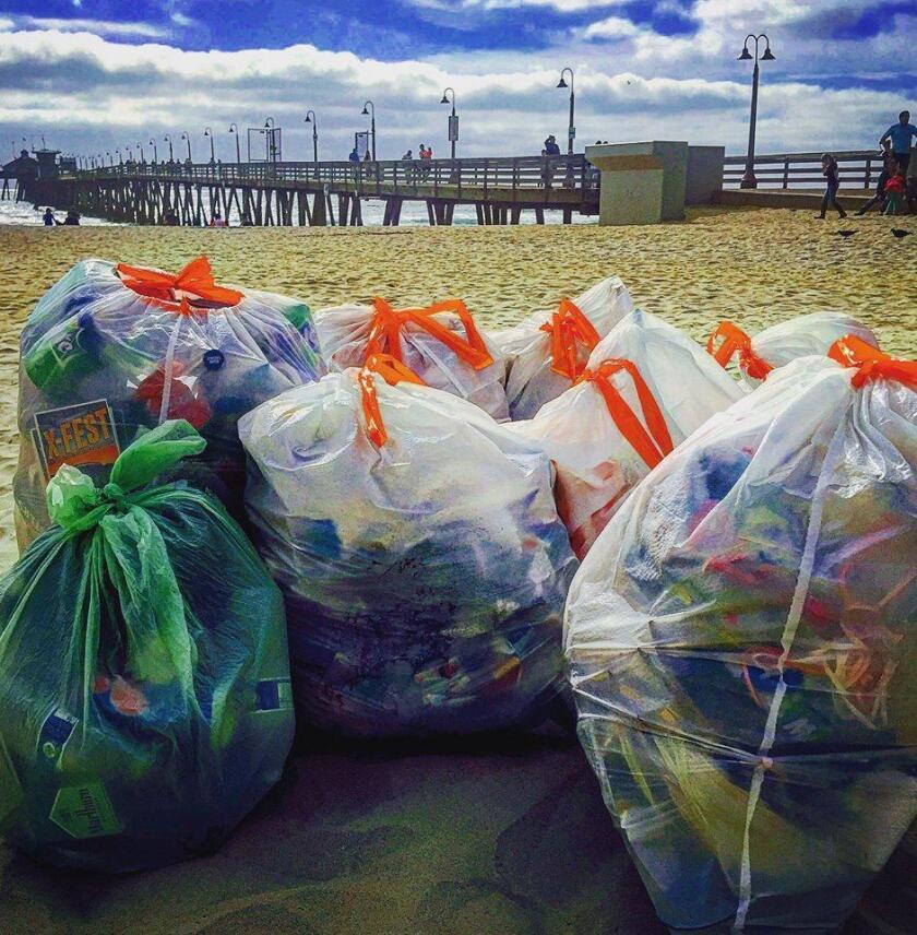 A few of the trash  bags filled by volunteers on July 5, for a post-Independence Day beach clean-up in coastal San Diego.